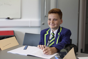 Boy smiling at desk